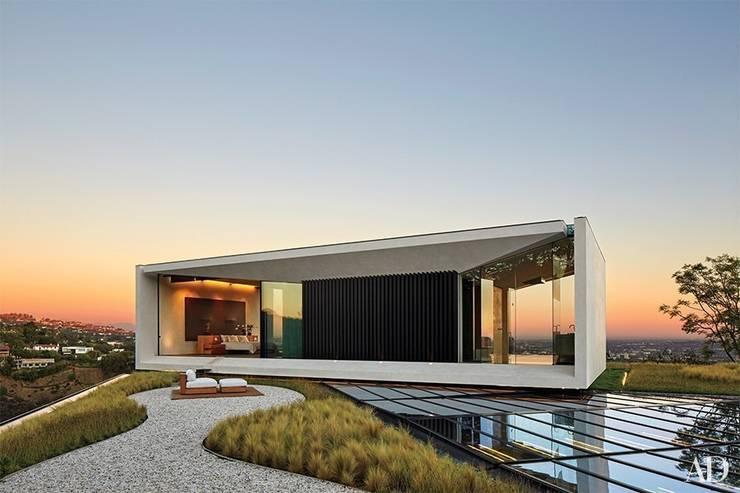 Projekty, nowoczesne Domy zaprojektowane przez Pietre di Rapolano
