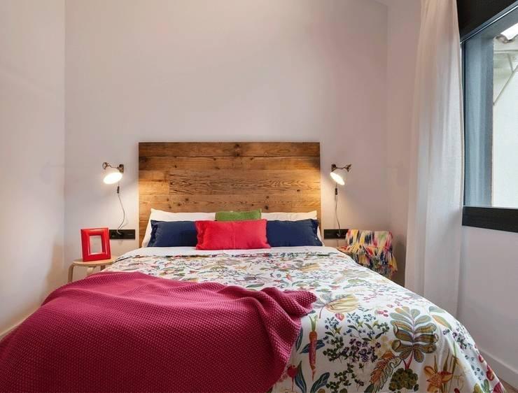 7 idee sensazionali per una camera da letto con i pallet - Testiera letto pallet ...