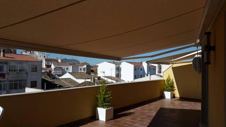 10 toldos que proteger n tu terraza y la har n ver for Que significa terraza