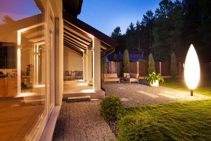 Paredes y pisos de estilo rústico por The Wood Galleries