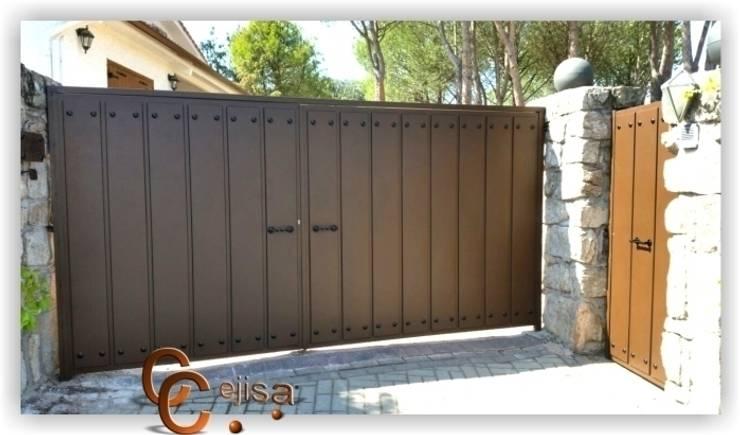 Puertas y vallas de cerrajeria cejisa homify - Puertas de hierro para exteriores ...