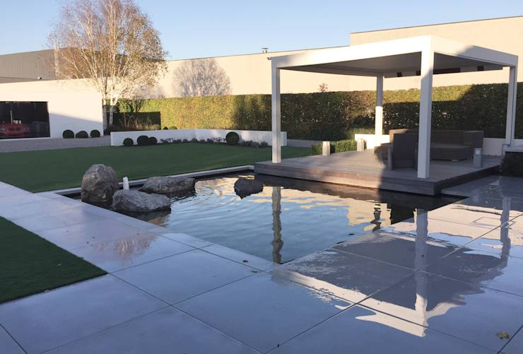 Zelf een vijver aanleggen in negen simpele stappen for Moderne waterpartijen tuin