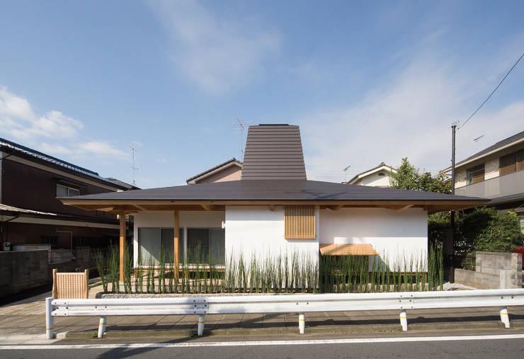 木造伝統工法のA邸: 建築設計事務所 山田屋が手掛けたtranslation missing: jp.style.家.eclectic家です。