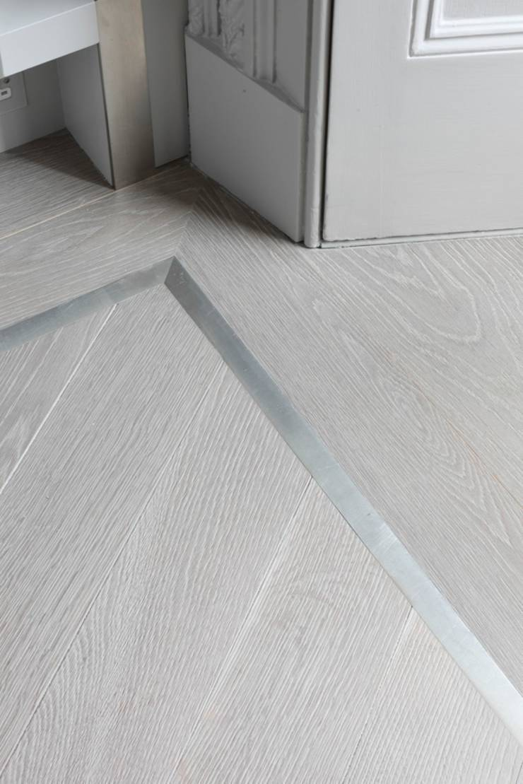 Ash grey engineered wood flooring was laid in a chevron pattern and ...