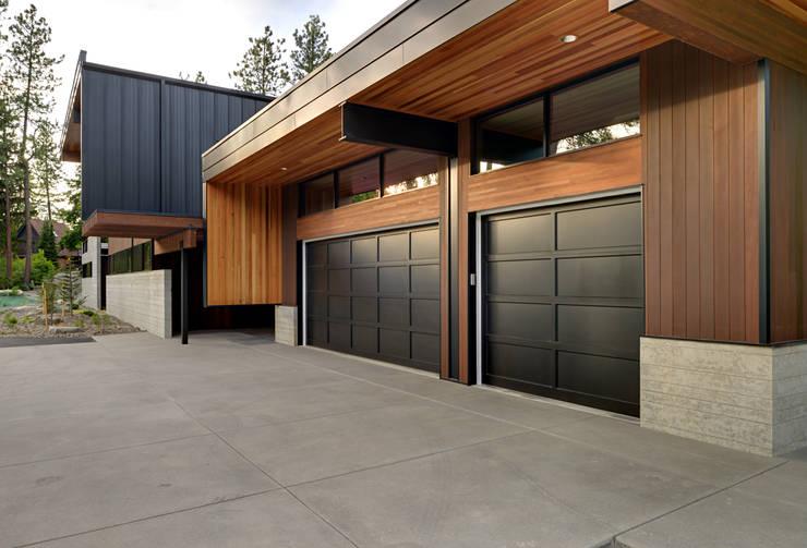 modern Garage/shed by Uptic Studios