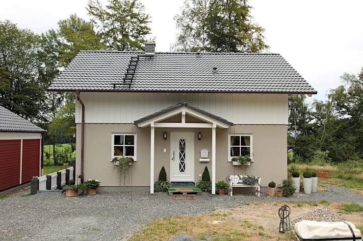 Casas de estilo rural por FingerHaus GmbH