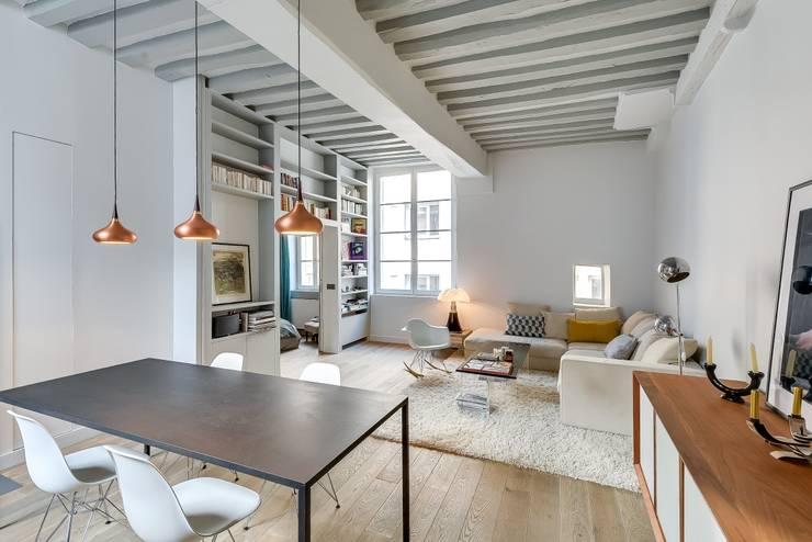 Salas de estilo industrial por Meero