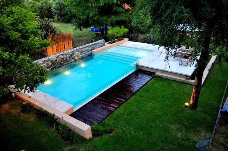 13 dise os de piscinas elevadas para tu jard n for Ideas para decorar alrededor de la piscina