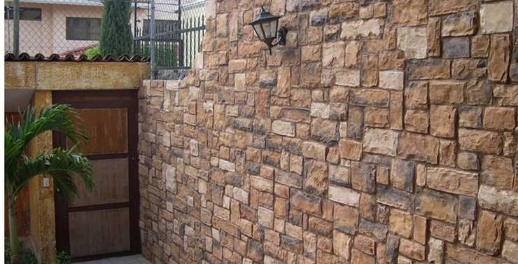 10 ideas para decorar tus paredes con el material m s - Tipos de revestimientos exteriores ...