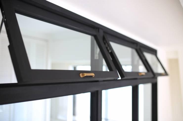 8 estilos de ventanas para casas peque as y grandes for Puertas que abren hacia afuera