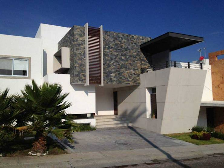 13 fachadas de casas modernas con revestimiento de piedra for Casas con piedras en la fachada