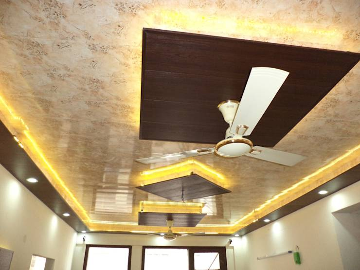 False ceiling design and wallpaper by Mohali Interiors ...