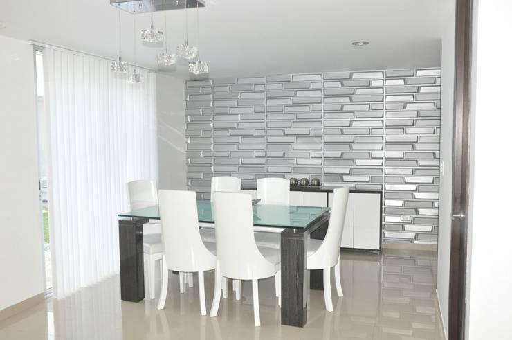 Proyecto Interiorismo: Comedores de estilo moderno por Decoespacios