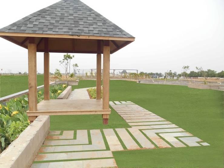 Jardines de estilo moderno por Indish Landscapes