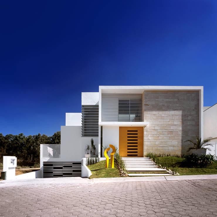 10 combinaciones de colores que har n que tu fachada se for Fachadas casas color arena