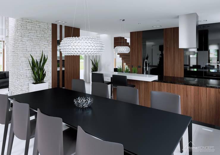 Comedores de estilo moderno por HomeKONCEPT | Projekty Domów Nowoczesnych