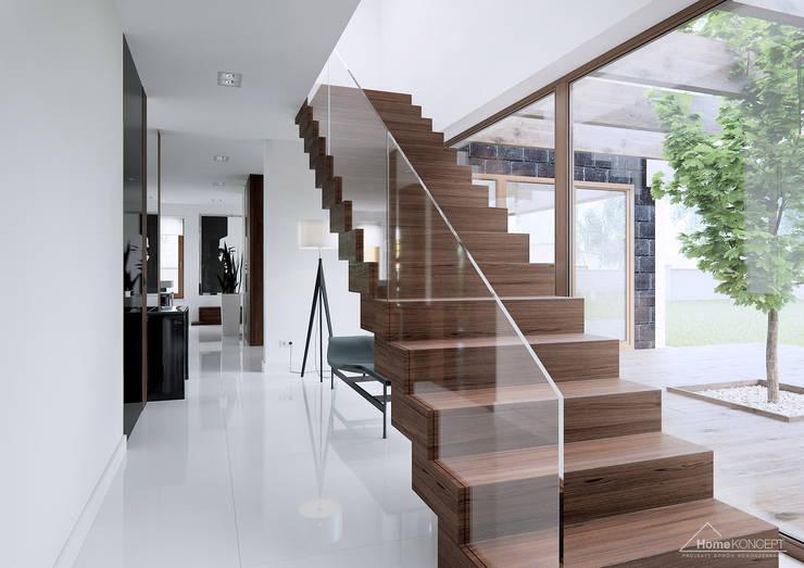 Pasillo, hall y escaleras de estilo translation missing: mx.style.pasillo-hall-y-escaleras.moderno por HomeKONCEPT | Projekty Domów Nowoczesnych