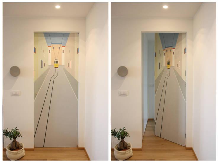 Pasillos, vestíbulos y escaleras de estilo translation missing: ve.style.pasillos-vestíbulos-y-escaleras.eclectico por studio ferlazzo natoli
