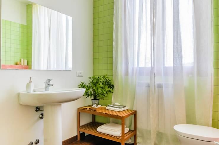 Bathroom:  in stile  di Venduta a Prima Vista