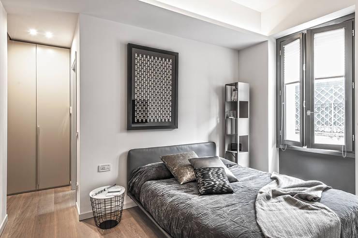 66 metri quadri: Camera da letto in stile in stile Moderno di BRANDO concept