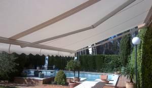 TOLDOS: Balcones y terrazas de estilo  de TOLDOS TOLVEN