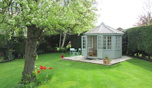Wiveton Summerhouse with Weathered Cedar Shingles:  Garages & sheds by CraneGardenBuildings