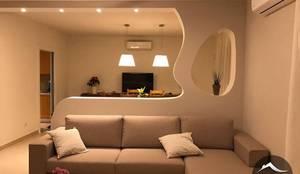 Parete di arredo in cartongesso: Ingresso, Corridoio & Scale in stile  di Cartongesso Design