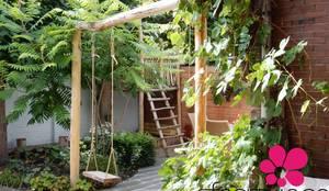 Schommelaar in het hart van de tuin.: landelijke Tuin door Sfeertuinen
