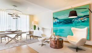 DECORAÇÃO DE APARTAMENTOS ELEGANTE : Sala de estar  por Glim - Design de Interiores