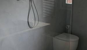 Ristrutturazione completa bagni finitura pareti e pavimenti in