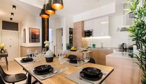 Zona de día de la vivienda de Nadav: Comedor de estilo  de Rez estudio