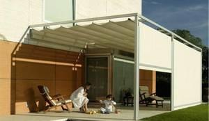 Corredero marino con verticales : Jardín de estilo  de TOLDOS CLOT, S.L.