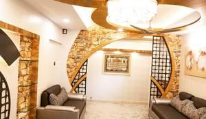 Bramha exubrance 2bhk:  Living room by Envoy Interiors Pvt ltd