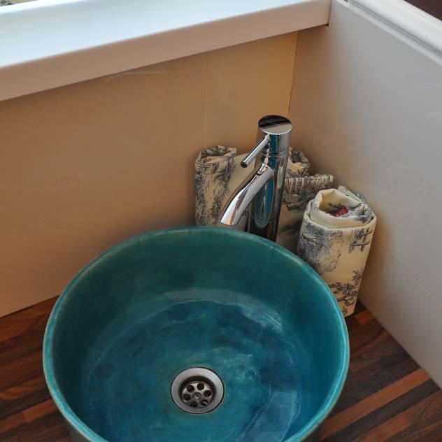 Baños de estilo rústico por Florisa