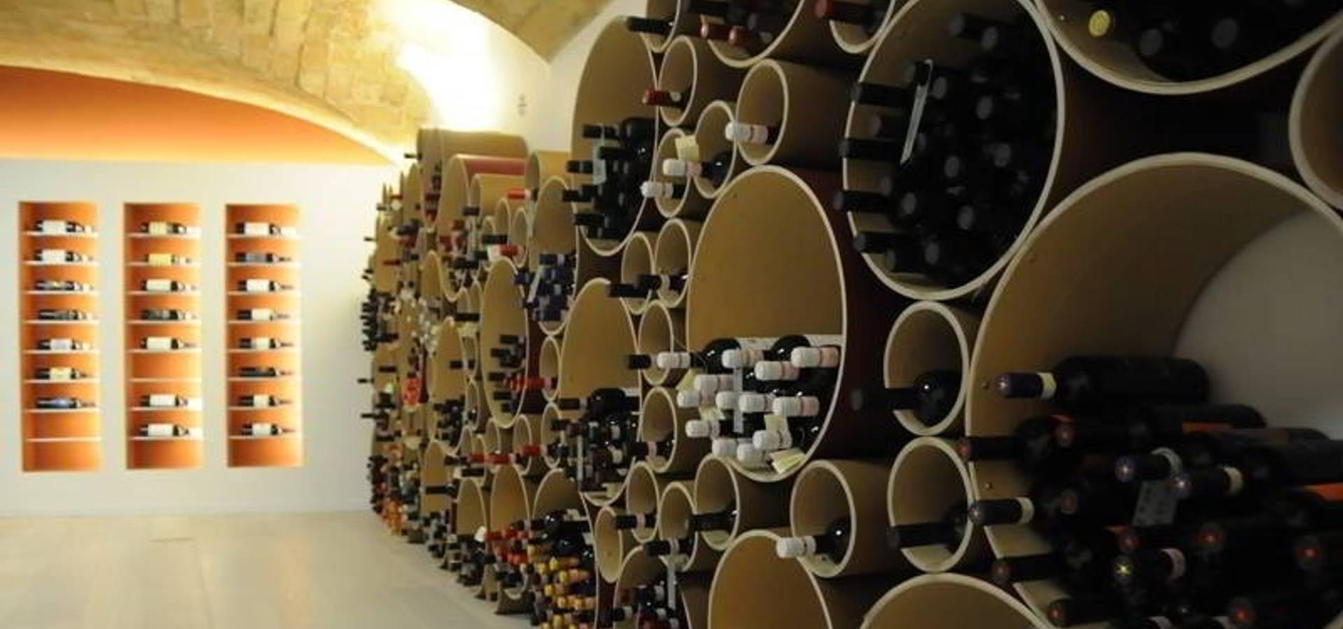 Arredamento esigo per enoteca e punto vendita vino di for Arredamento cantina vino