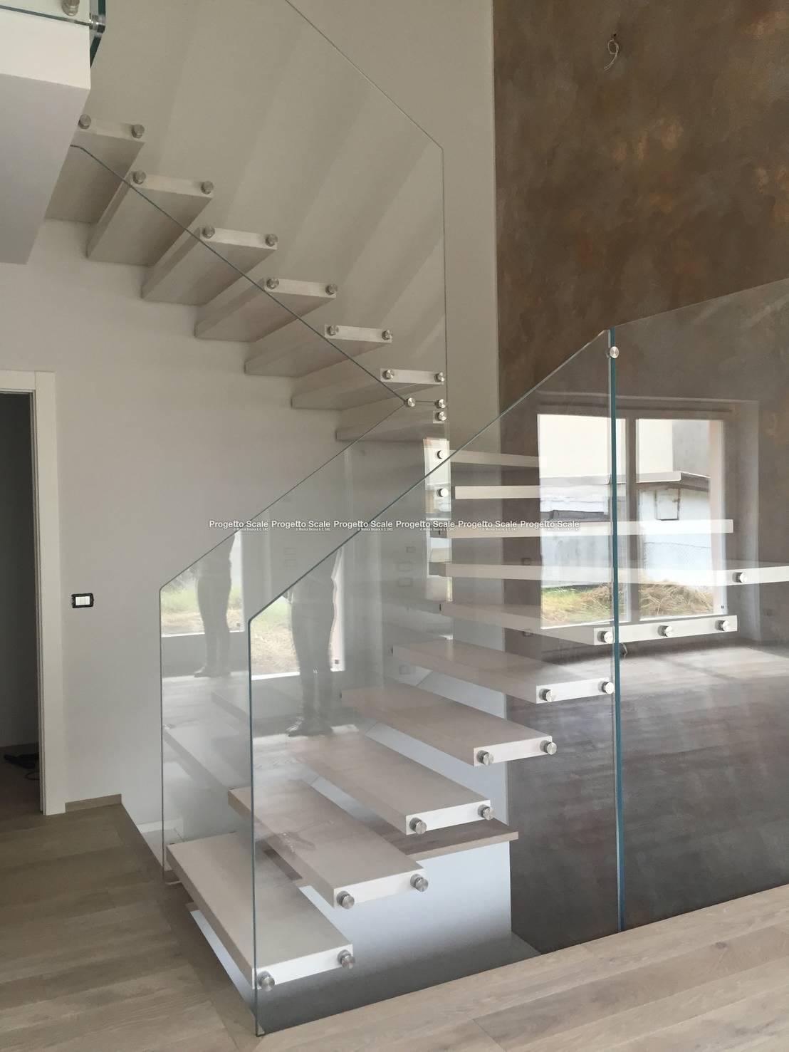 Scala a sbalzo parapetti in cristallo di progetto scale di monica besana c snc homify - Progetto scale interne ...