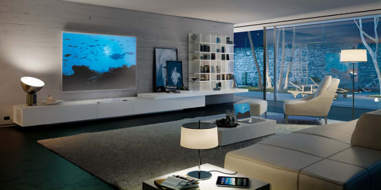 Un soggiorno moderno parete attrezzata con stile for Pareti tv moderne