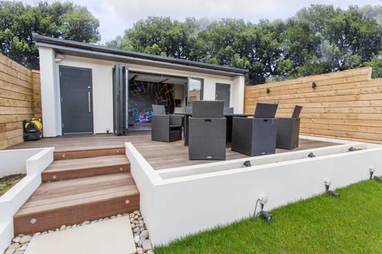 7 bonitas terrazas en desnivel que podr s dise ar en tu patio for Ideas jardin desnivel
