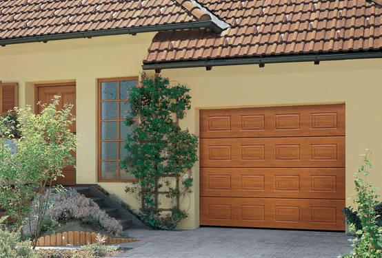 Garajes 10 ventajas de las puertas seccionales for Puertas para garajes