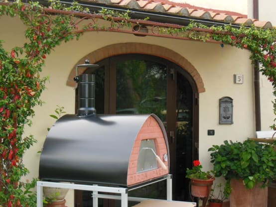 Outdoor wood fired oven Pizza Party in garden location