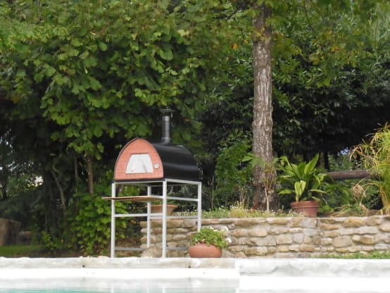 Wood burning oven Pizza Party in garden or patio location