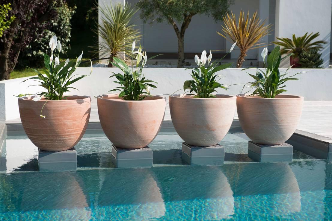 Patios modernos 10 macetas de barro encantadoras - Soportes para macetas de interior ...