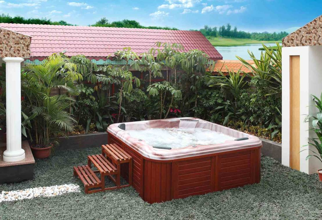 las refrescantes burbujas de un jacuzzi exterior. Black Bedroom Furniture Sets. Home Design Ideas