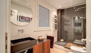 Casas de banho modernas por MOB ARCHITECTS