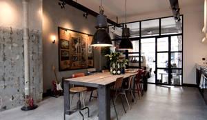 industrial Dining room by BRICKS Studio