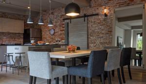 Comedores de estilo industrial por MARIANGEL COGHLAN
