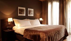 Habitación: Hoteles de estilo  de Gramil Interiorismo II - Decoradores y diseñadores de interiores