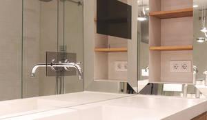 Banheiros modernos por Miriam Barrio