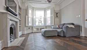 minimalistische Woonkamer door A1 Lofts and Extensions