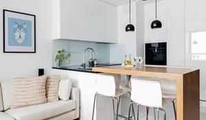 minimalistic Dining room by Ayuko Studio